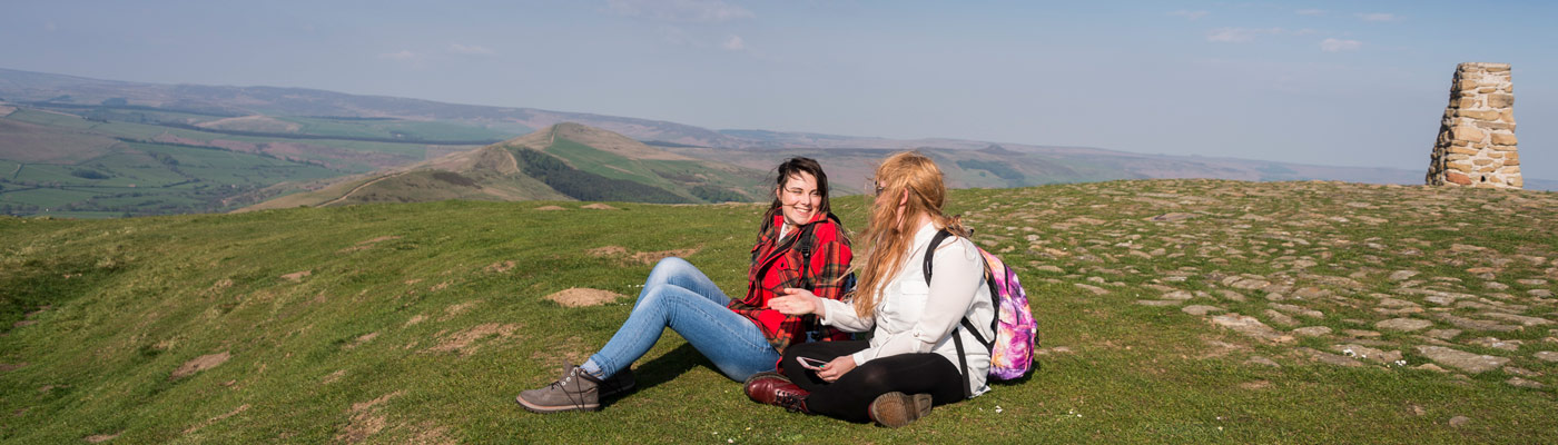 Two students sat at the top of Mam Tor in the High Peak