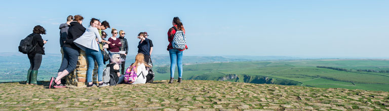 Students at the top of Man Tor in High Peak.